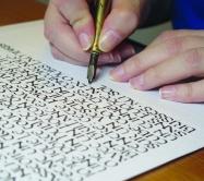 Main qui calligraphie